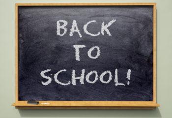 'Back to School' written on a school blackboard